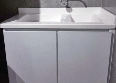 Mueble de lavadero en fórmica con lavadero en policuarzo